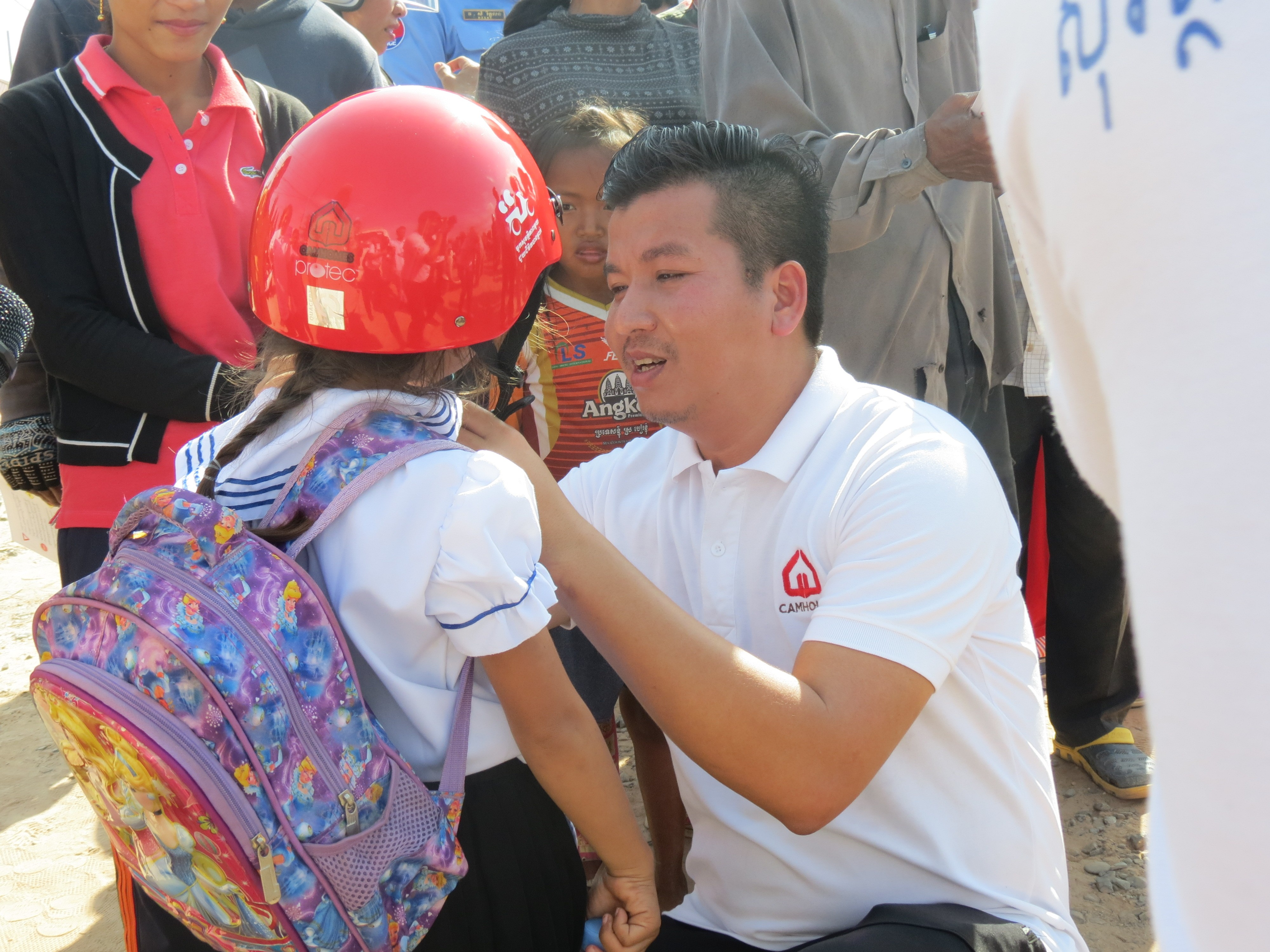 Children and residents of Preah Sihanouk province receive helmet and safety education