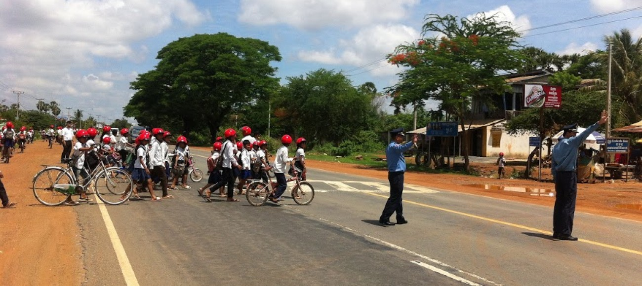 Police help students across a road